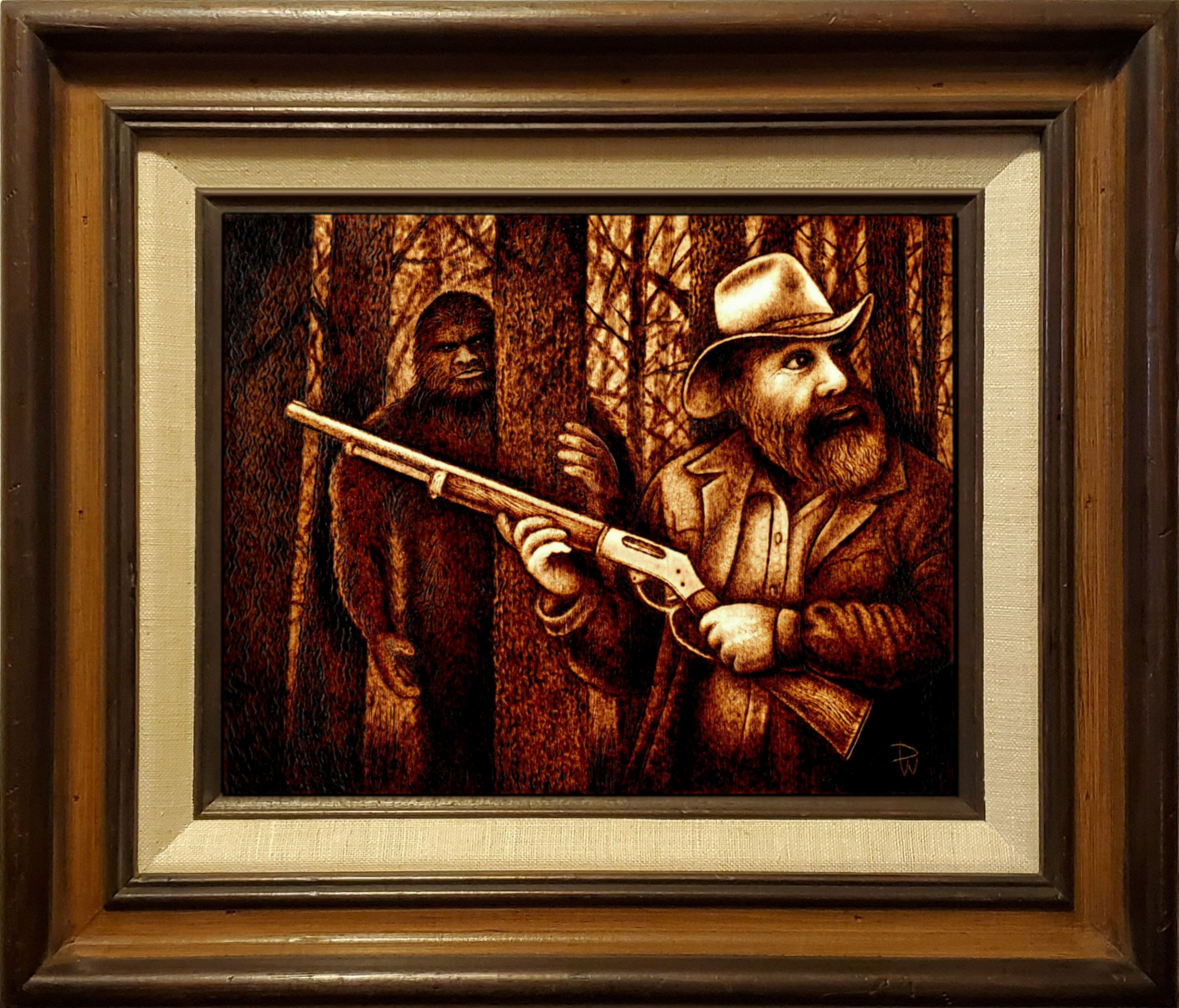 Pyrographic image of a hunter being stalked by sasquatch bigfoot creature