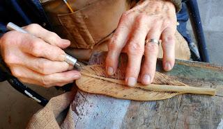 Close-up of Bob detailing his artwork.