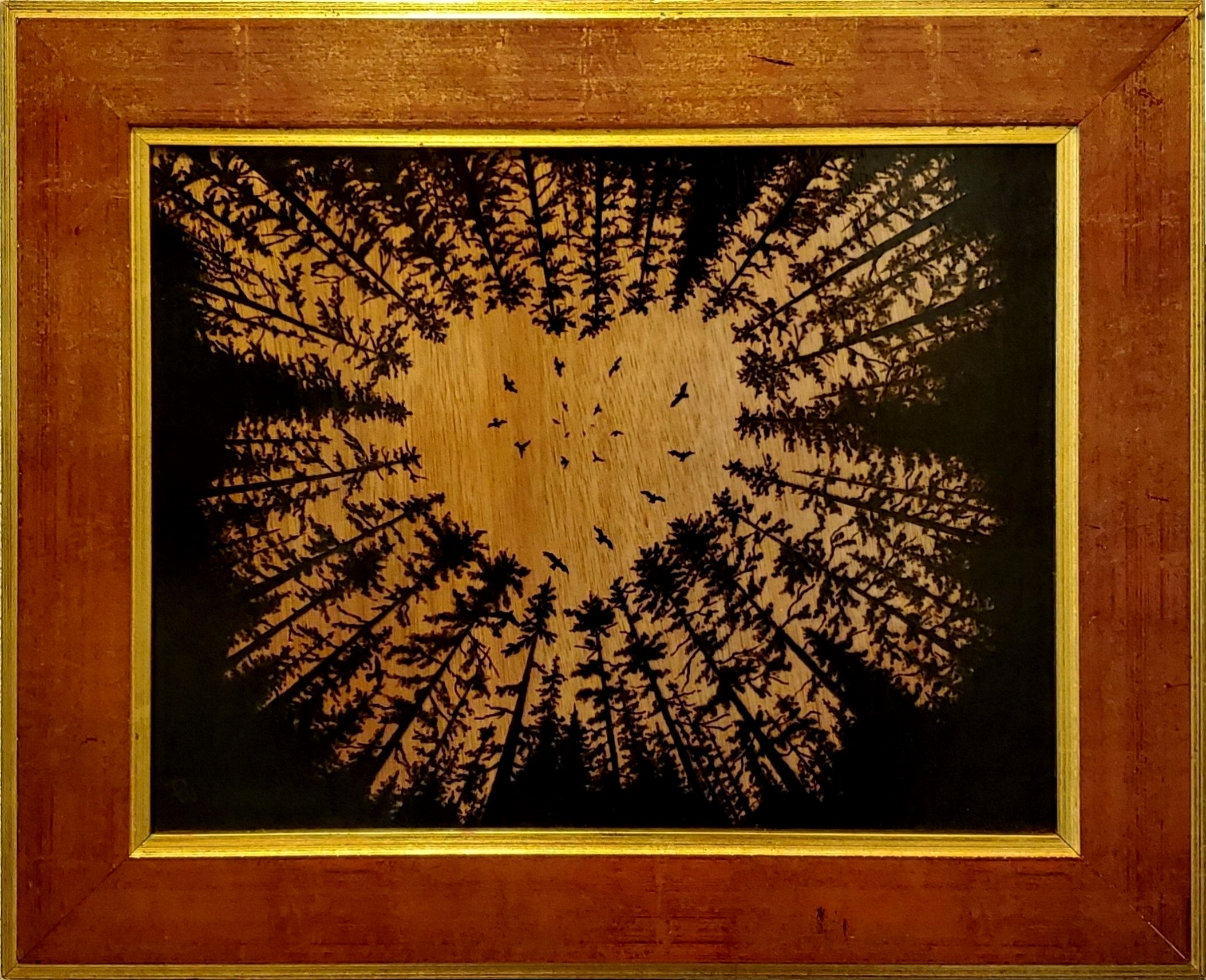 Woodburned image of trees with a heart-shaped opening above