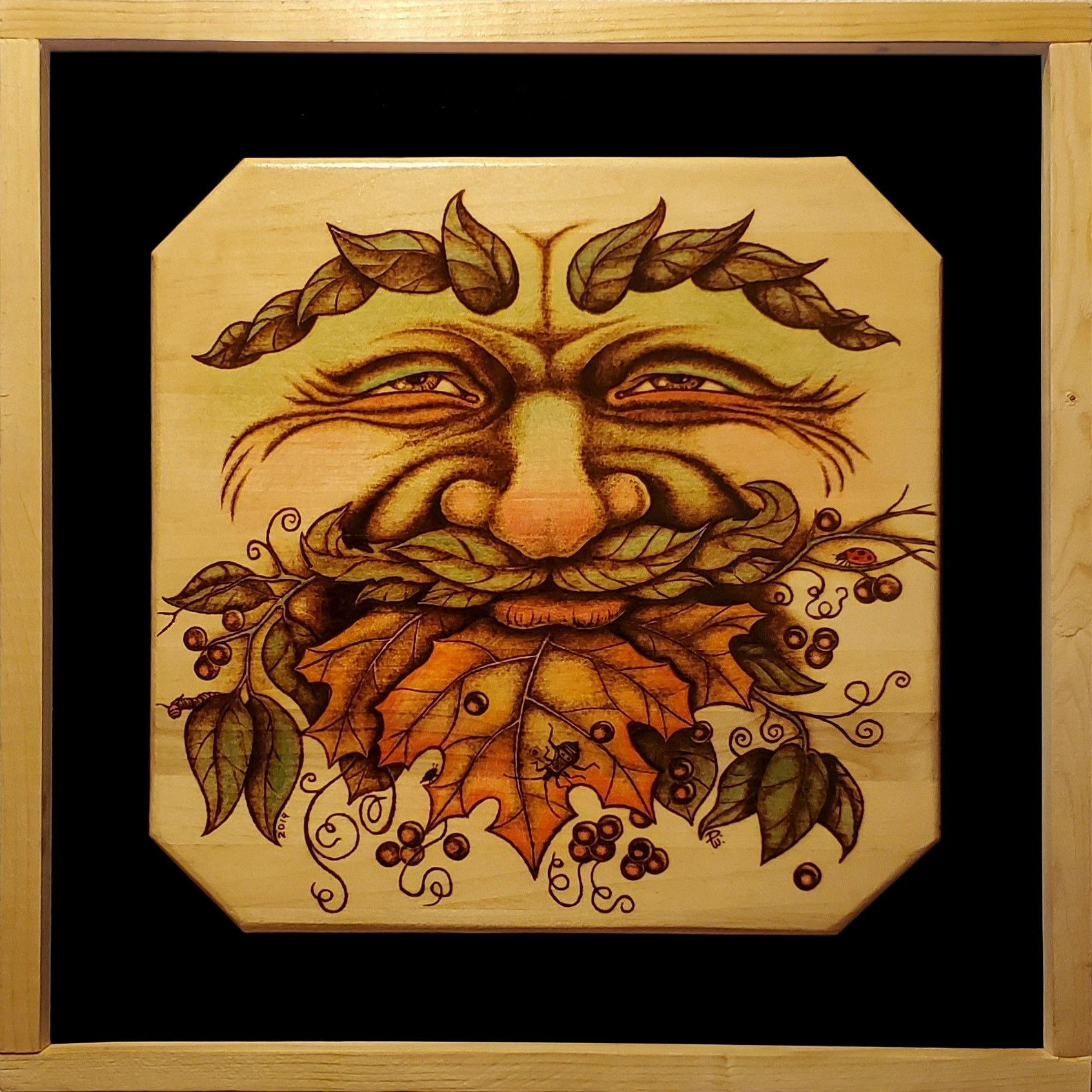 Woodburned image of the European greenman motif
