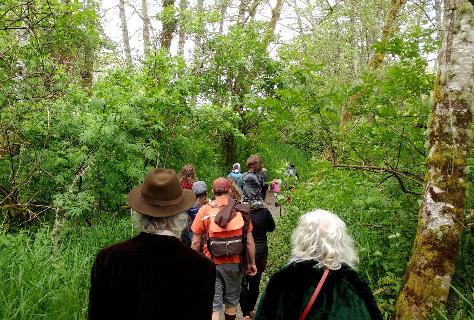 Oregon Art-lovers strolling through the park near Astoria.