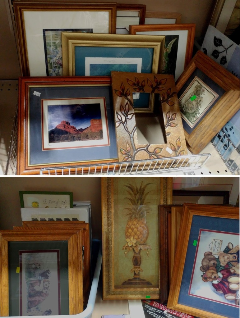 Used frames displayed at a thrift shop.