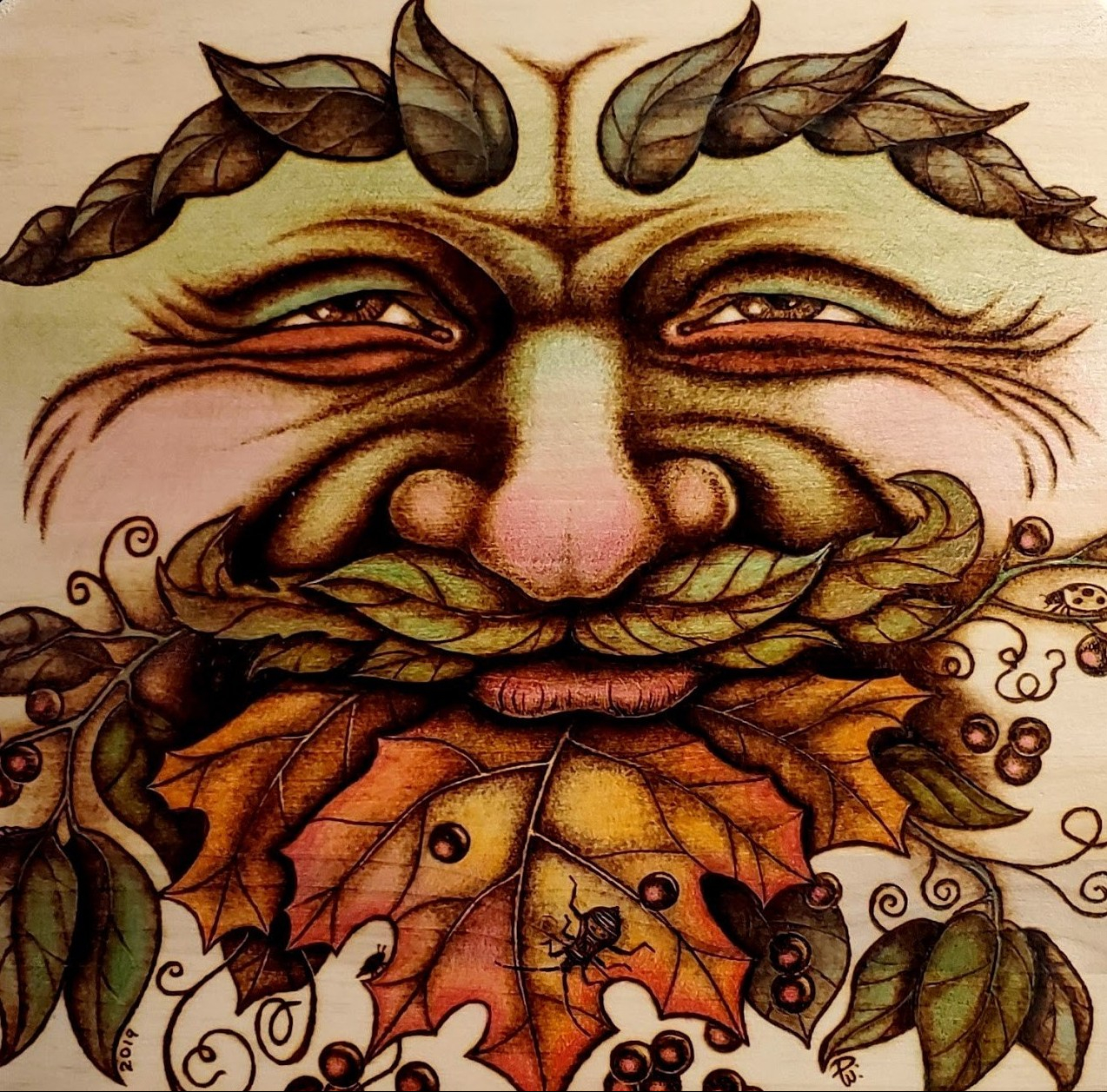 "Don White's woodburned artwork -- ""Oregon Green Man."""