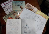Books and magazines filled with images for woodburned art patterns.