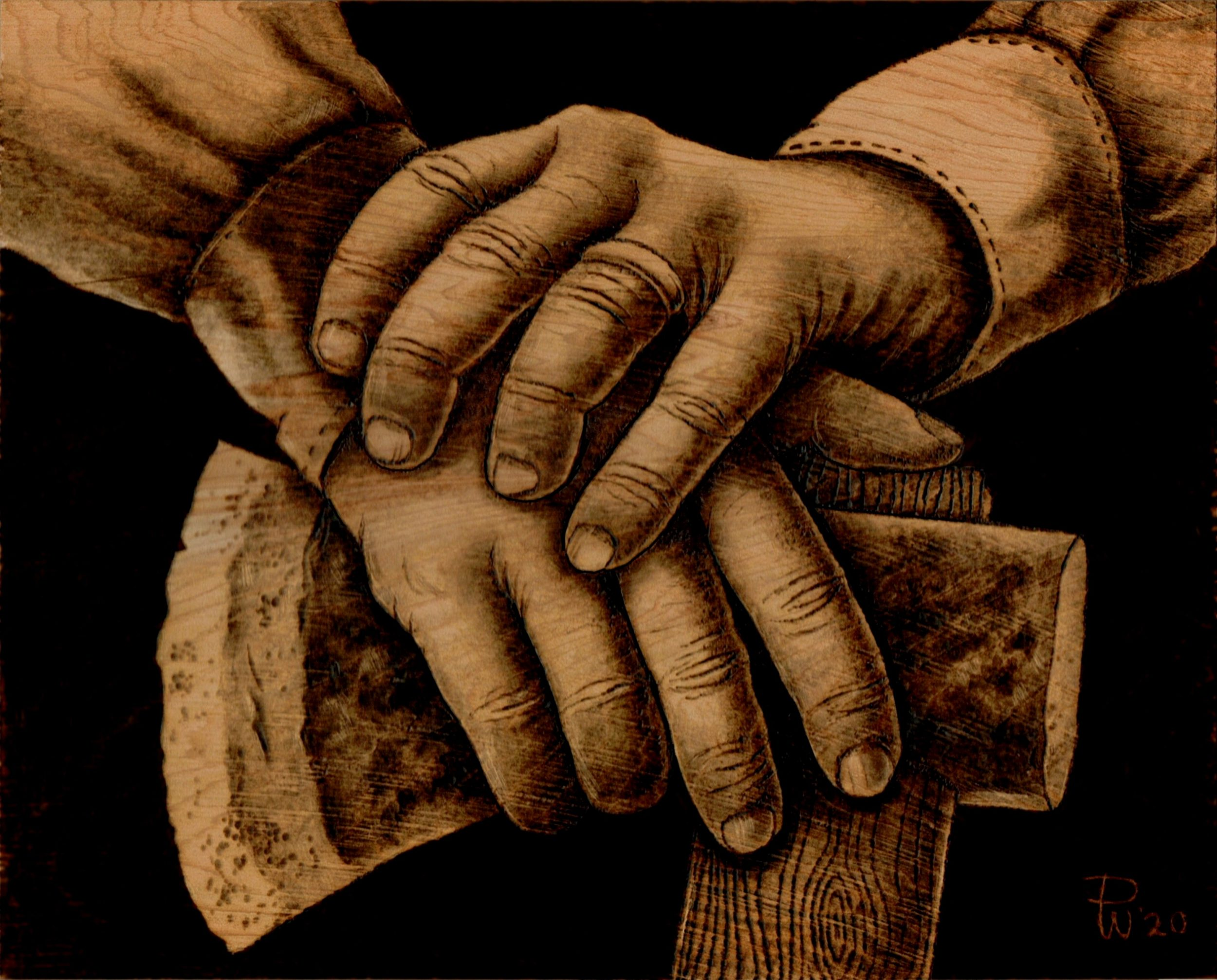 Hands of woodcutter or logger resting on axe - pyrography