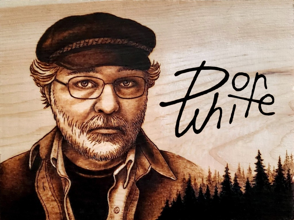 Self-portrait of Don White, burned onto wood.